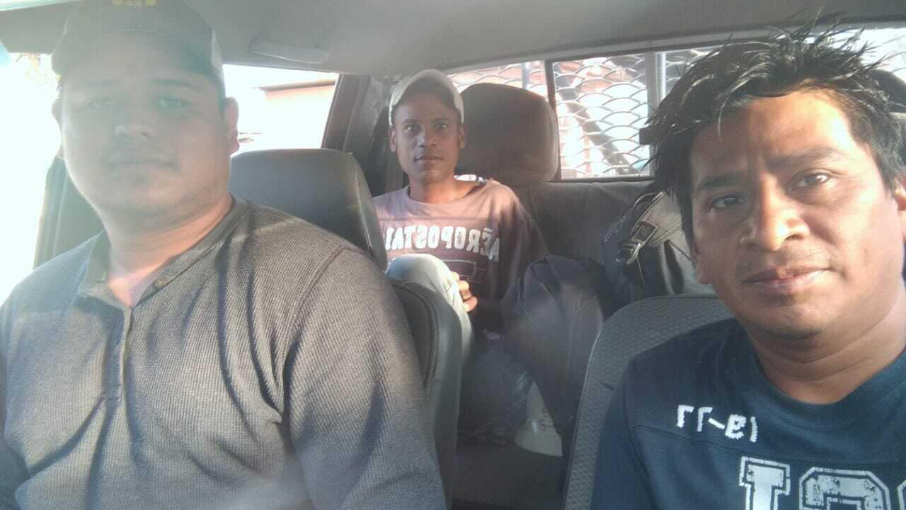 Three men in a car